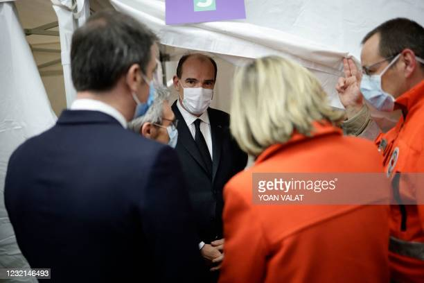 French Prime Minister Jean Castex speaks with French Red Cross workers during a visit of the Covid-19 vaccination center setup inside the Stade de...