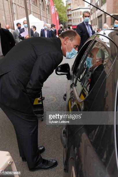 French Prime Minister Jean Castex talks to a person who came for testing at the screening drive center of the Pasteur Institute of Lille as part of a...