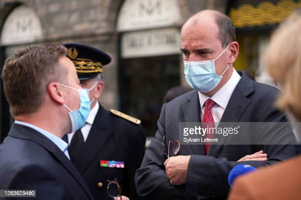 French Prime Minister Jean Castex talks to a representative of the town's merchants in the streets as part of a visit to Lille on August 03 2020 in...