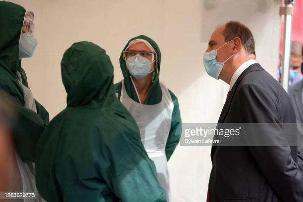 French Prime Minister Jean Castex talks to laboratory technicians of the screening drive center of the Pasteur Institute of Lille as part of a visit...