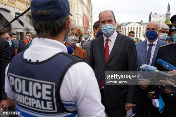French Prime Minister Jean Castex talks to policemen in the streets as part of the visit in Lille which made from today the wearing of masks...