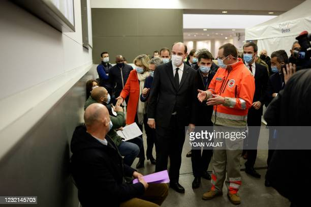 French Prime Minister Jean Castex visits the Covid-19 vaccination center setup inside the Stade de France stadium in Saint-Denis, near Paris, on its...