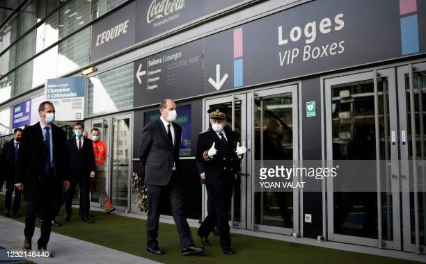 French Prime Minister Jean Castex walks with Seine-Sainte-Denis' prefect Georges-François Leclerc as he arrives for a visit of the Covid-19...