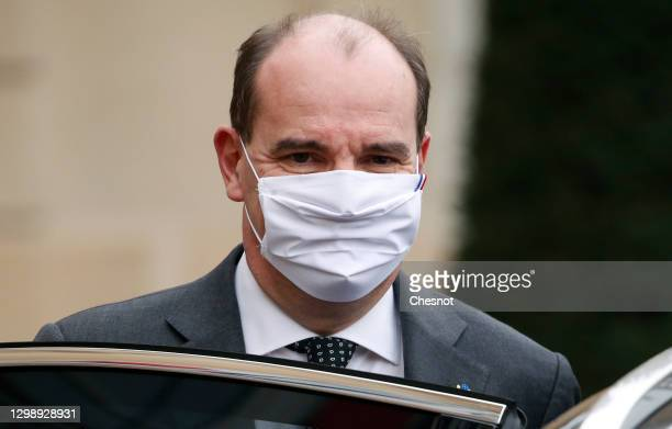 French Prime Minister Jean Castex, wearing a protective face mask, leaves after the weekly cabinet meeting at the Elysee Palace on January 27, 2021...
