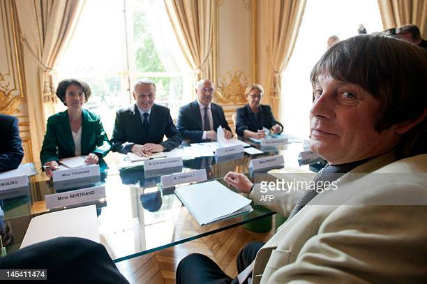 French Prime Minister JeanLuc Ayrault and French CGT labour union leader Bernard Thibault take part in a meeting on May 29 2012 at the Hotel Matignon...