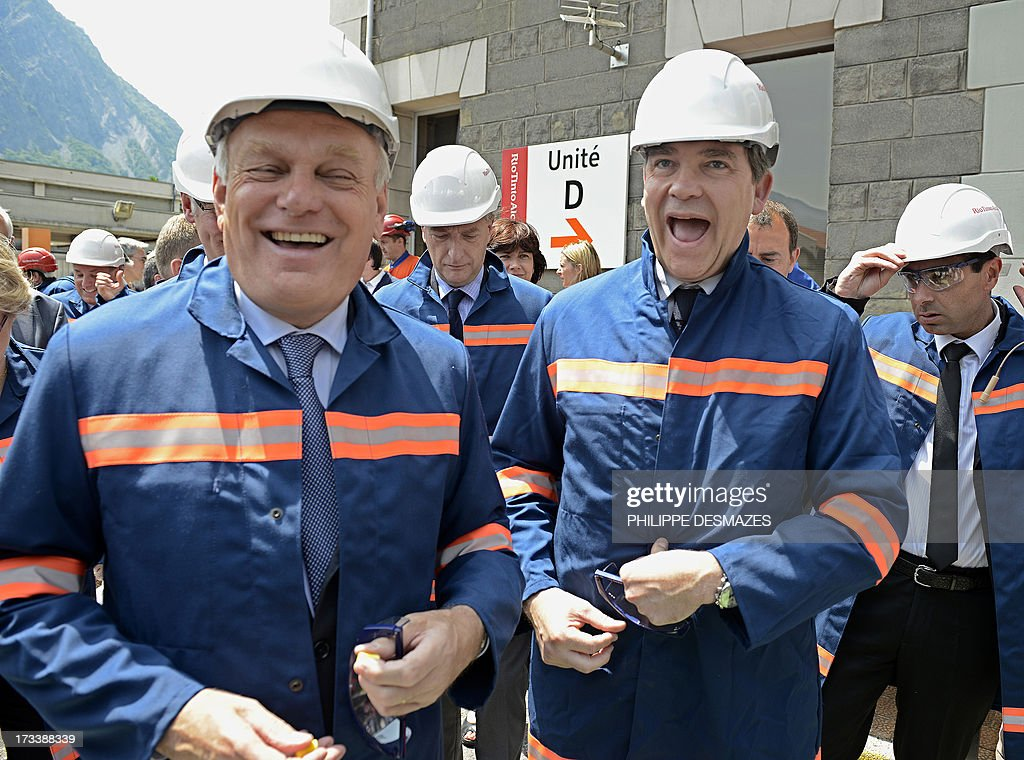 French Prime minister Jean-Marc Ayrault (L) and French Minister for Industrial Renewal and Food Industry Arnaud Montebourg (R) share a joke as they arrive to visit the Rio Tinto Alcan (RTA) aluminum factory in Saint-Jean-de-Maurienne, southeast of France, on July 13, 2013. Heads of Rio Tinto Alcan and Germany's Trimet met today in Paris regarding the take over of RTA by Trimet which could save 510 jobs at the two sites of Saint-Jean-de-Maurienne (Savoie) and Castelsarrasin (Tarn-et-Garonne) .
