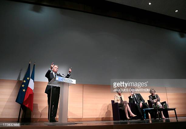 French Prime Minister JeanMarc Ayrault delivers a speech as Social Affairs and Health Minister Marisol Touraine Minister for Industrial Renewal and...
