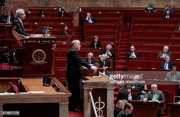 French Prime Minister Jean-Marc Ayrault delivers a speech in front of the President of the French National Assembly Claude Bartolone in the National...