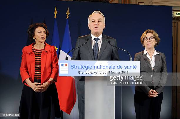 French Prime Minister JeanMarc Ayrault flanked by Marisol Touraine French Social Affairs and Health Minister and Genevieve Fioraso French Minister...