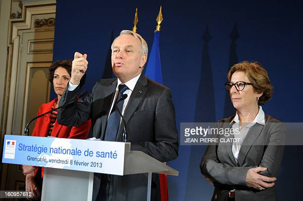 French Prime Minister JeanMarc Ayrault flanked by Social Affairs and Health Minister Marisol Touraine and Minister for Higher Education and Research...