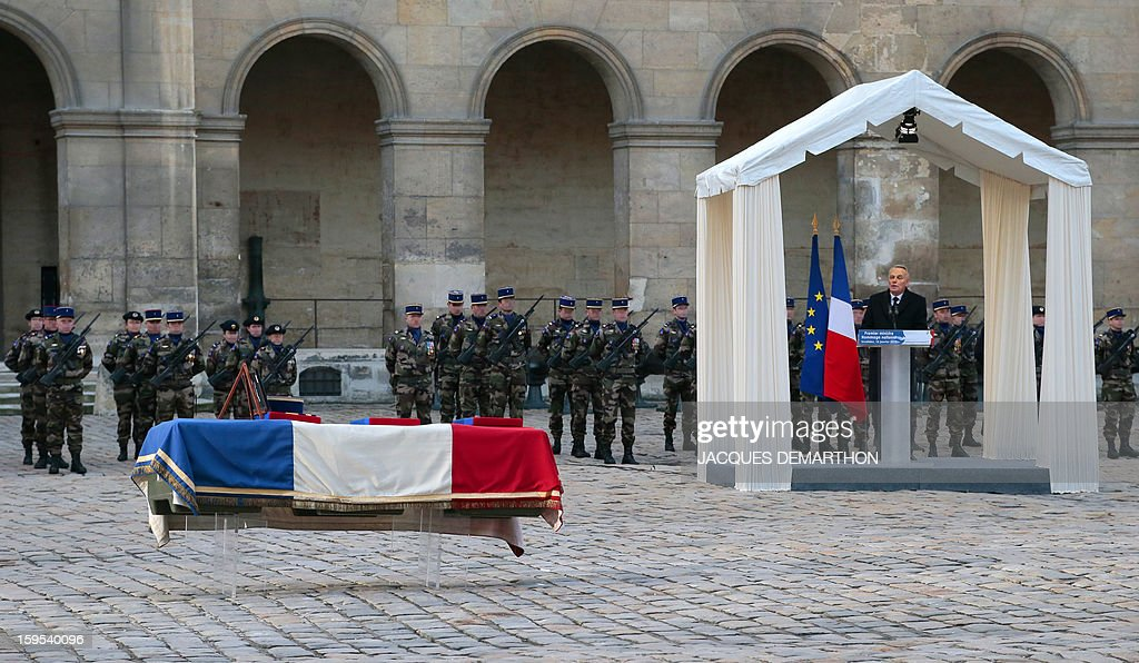 French Prime Minister Jean-Marc Ayrault gives a speech during a funeral service for French air force lieutenant Damien Boiteux at the Invalides courtyard in Paris, on January 15, 2013. French pilot Damien Boiteux was killed on January 11 during a helicopter raid launched to support Mali ground troops in the battle for the key town of Kona, and to prevent Islamist groups controlling northern Mali from advancing toward the capital Bamako.