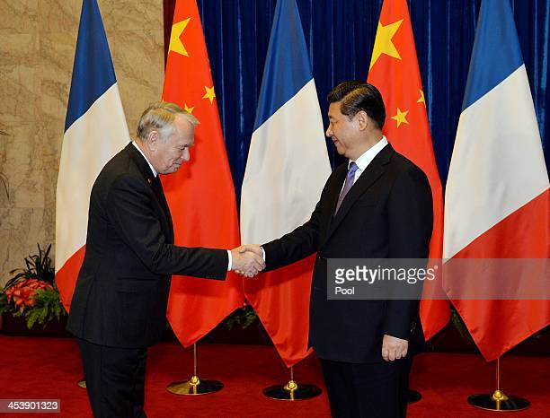 French Prime Minister Jean-Marc Ayrault is greeted by the Chinese President Xi Jinping during their meeting inside the Great Hall of the People on...