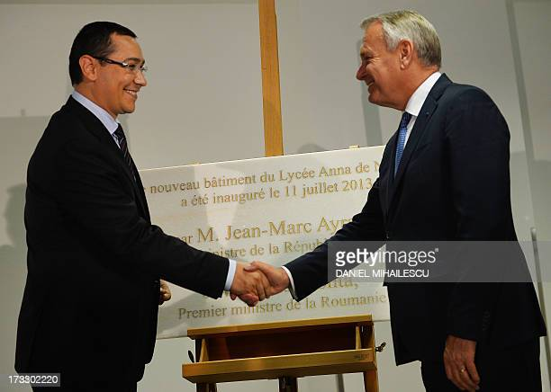 French Prime Minister JeanMarc Ayrault shakes hands with Romanian Prime Minister Victor Ponta during the unveiling of the comemorative plate at The...