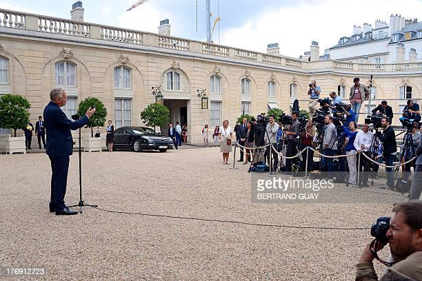 French Prime Minister Jean-Marc Ayrault speaks to the press at the Elysee Palace in Paris on August 19, 2013 after a seminar on the government's...