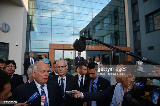 French Prime Minister JeanMarc Ayrault talks to journalists in front of the French High School Anna de Noailles at in Bucharest on July 11 2013 AFP...