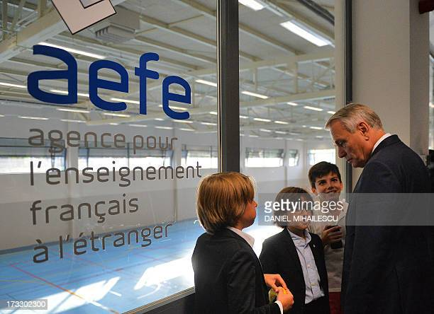 French Prime Minister JeanMarc Ayrault talks to pupils at the French High School Anna de Noailles at in Bucharest on July 11 2013 AFP PHOTO DANIEL...