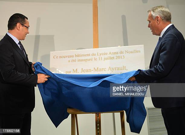 French Prime Minister JeanMarc Ayrault unveils the comemorative plate during the opening ceremony of The French High School Anna de Noailles with...