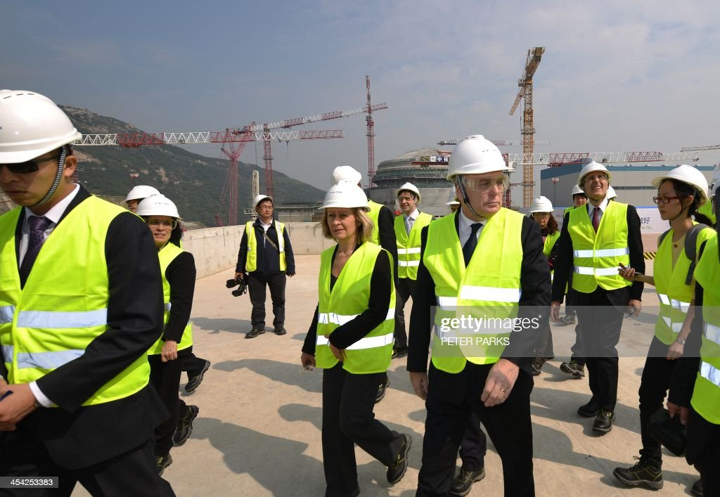 French Prime Minister Jean-Marc Ayrault (centre R) visits the joint Sino-French Taishan Nuclear Power Station outside Taishan City in Guandong province on December 8, 2013. French Prime Minister Jean-Marc Ayrault touted his country's nuclear expertise during his visit to China -- the world's largest market for atomic power stations. AFP PHOTO/Peter PARKS