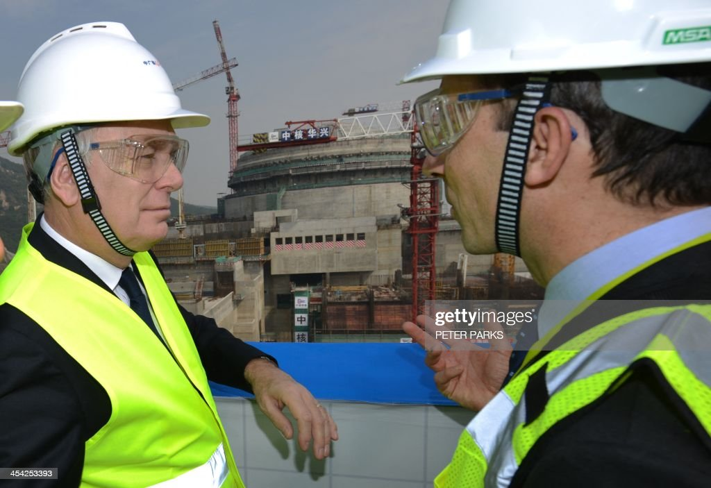 French Prime Minister Jean-Marc Ayrault (L) visits the joint Sino-French Taishan Nuclear Power Station outside Taishan City in Guandong province on December 8, 2013. French Prime Minister Jean-Marc Ayrault touted his country's nuclear expertise during his visit to China -- the world's largest market for atomic power stations. AFP PHOTO/Peter PARKS