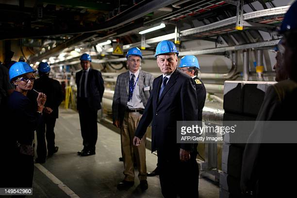 French Prime Minister JeanMarc Ayrault visits the Large Hadron Collider a particle accelerator used by physicists to study the smallest known...