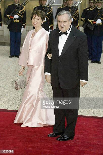 French Prime Minister Jean-Pierre Raffarin arrives with his wife Anne-Marie at the Elysee Palace for a state banquet hosted by French President...