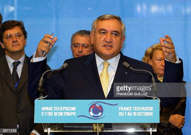 French Prime Minister JeanPierre Raffarin makes a speech during his visit to the France technologie exhibition in Moscow 07 October 2003 Raffarin was...