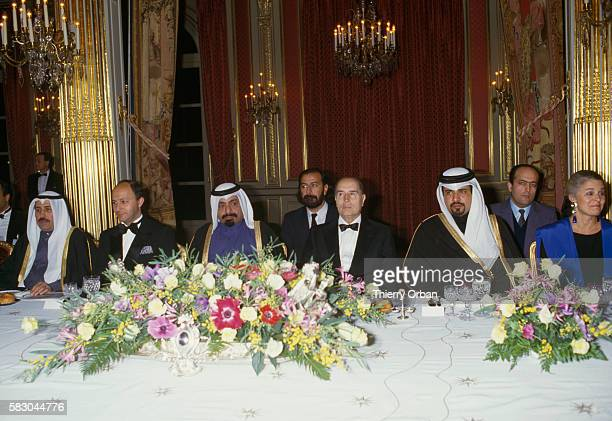 French prime minister Laurent Fabius Sheik Khalifa bin Hamad alThani Emir of Qatar and French president Francoise Mitterrand attend a gala dinner at...