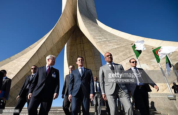 French Prime Minister Manuel Valls Algerian Interior Minister Noureddine Bedoui and French ambassador to Algeria Bernard Emie leave after visiting...