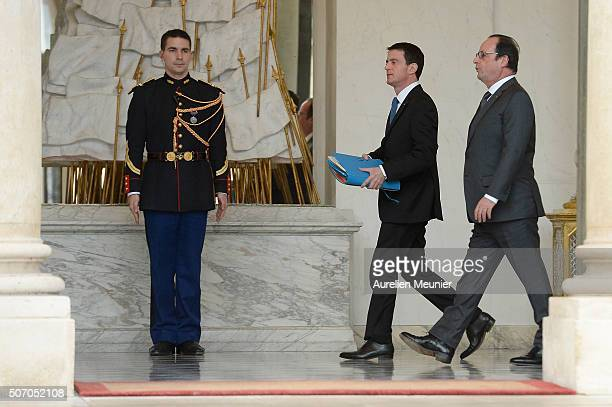 French Prime Minister Manuel Valls and French President Francois Hollande walk by at the Elysee Palace after the weekly cabinet meeting at Elysee...
