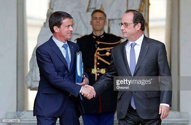 French Prime Minister Manuel Valls and French President Francois Hollande leave the Elysee Presidential Palace after a weekly cabinet meeting on...