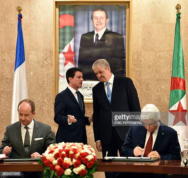 French Prime Minister Manuel Valls and his Algerian counterpart Abdelmalek Sellal attend a session of the agreement of signatures between Algerian...