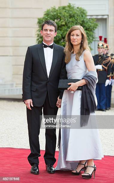 French Prime Minister Manuel Valls and his wife Anne Gravoin arrive at the Elysee Palace for a State dinner in honor of Queen Elizabeth II hosted by...