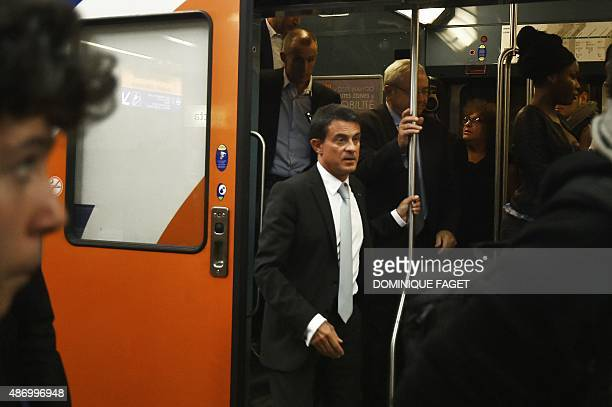 French Prime Minister Manuel Valls arrives at the Gare de Lyon train station at the end of his trip in a RER from Evry on September 5 2015 in Paris...