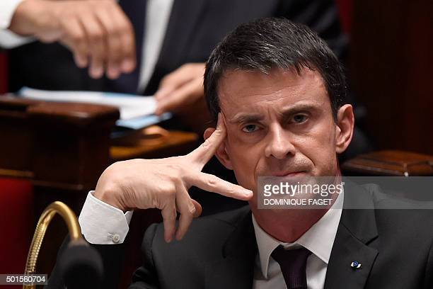 TOPSHOT French Prime minister Manuel Valls attends a session of questions to the government on December 16 2015 at the National Assembly in Paris AFP...