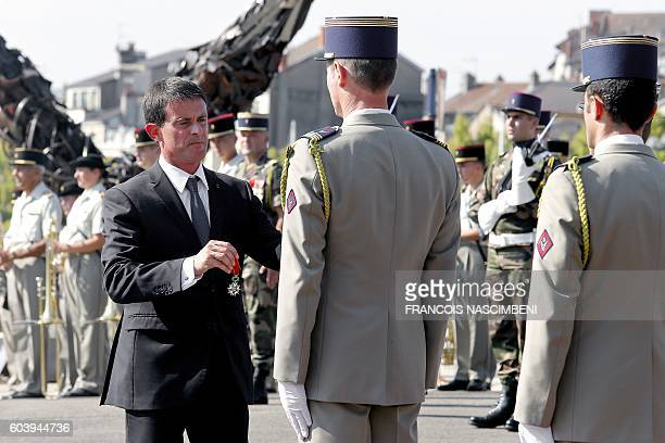 French Prime Minister Manuel Valls awards French servicemen from a helicopter regiment for feat of arms within a ceremony at the World War I memorial...