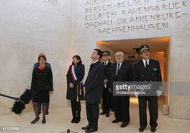 French Prime Minister Manuel Valls flanked by Aurelie Pol Director of important memorial sites in Ile de France region Paris Mayor Anne Hidalgo Paris...