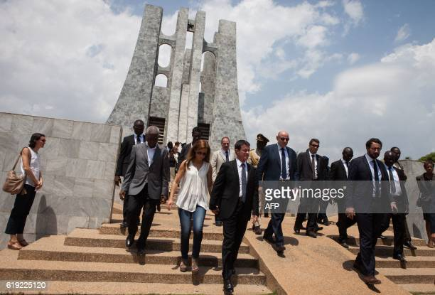French Prime Minister Manuel Valls flanked by his wife Anne Gravoin and Minister of State for Relations with Parliament JeanMarie Le Guen visits the...