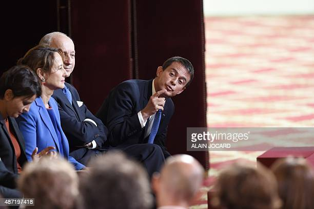 French Prime Minister Manuel Valls gestures as French Education minister Najat Vallaud-Belkacem , French minister for Ecology, Sustainable...