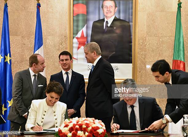 French Prime Minister Manuel Valls his Algerian counterpart Abdelmalek Sellal and French Justice minister JeanJacques Urvoas attend a session of the...