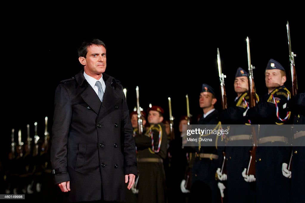 French Prime Minister Manuel Valls inspects the honour guard before talks with Czech Prime Minister Bohuslav Sobotka (not pictured) on December 8, 2014 in Prague, Czech Republic. Valls is on an official two-day visit to the Czech Republic.