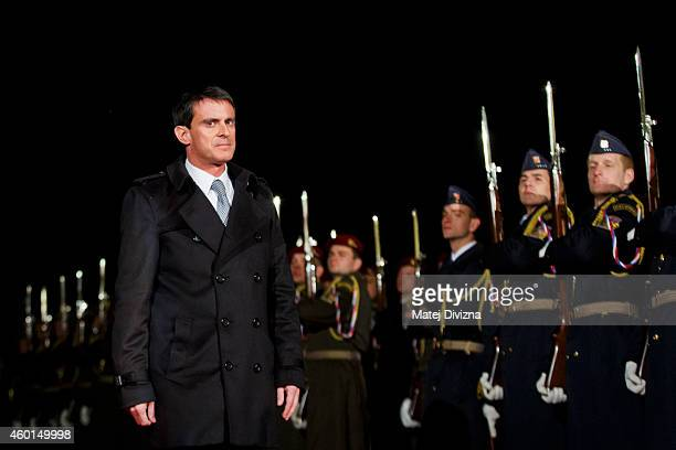French Prime Minister Manuel Valls inspects the honour guard before talks with Czech Prime Minister Bohuslav Sobotka on December 8 2014 in Prague...