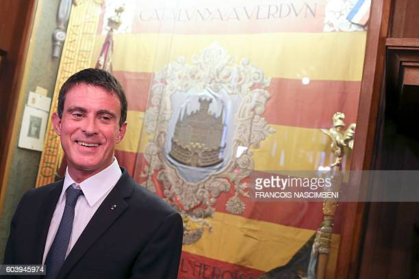 French Prime Minister Manuel Valls is pictured in front of the flag of Catalonia at the Verdun city hall northeastern France within a ceremony on...