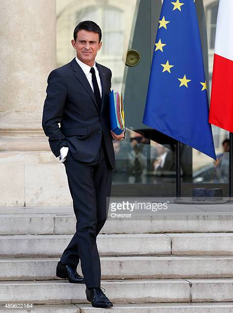 French Prime Minister Manuel Valls leaves after the Cabinet Meeting at the Elysee Palace on September 23 2015 in Paris France