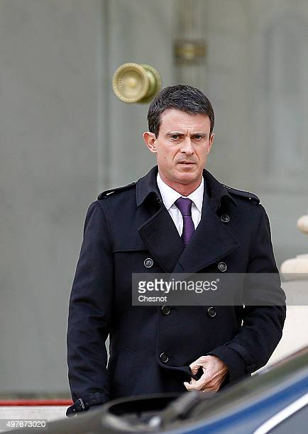French Prime minister Manuel Valls leaves after the weekly cabinet meeting at the Elysee Presidential Palace on November 18 2015 in Paris France It...