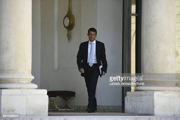 French Prime minister Manuel Valls leaves the Elysee Palace after a defence and security council on August 17, 2016. The safety feature to face the...