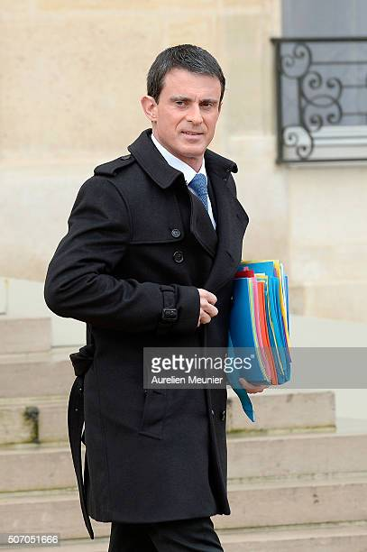 French Prime Minister Manuel Valls leaves the Elysee Palace after the weekly cabinet meeting at Elysee Palace on January 27 2016 in Paris France