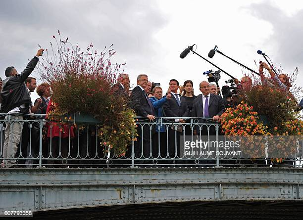 French Prime Minister Manuel Valls look at the canal of Briard as he visits Montargis on September 19 2016 to present a flood survey following the...