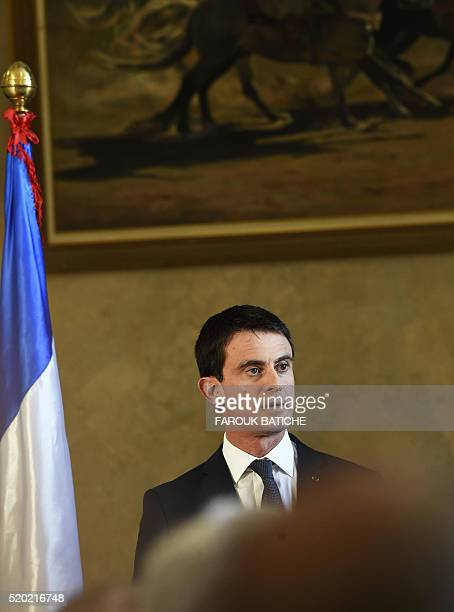 French Prime Minister Manuel Valls looks on during a press conference with his Algerian counterpart at the government palace in the capital Algiers...