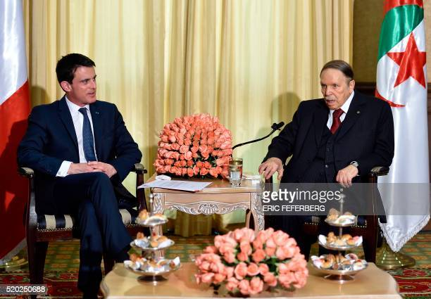 TOPSHOT French Prime Minister Manuel Valls meets Algerian President Abdelaziz Bouteflika at his residence during an official visit on April 10 2016...