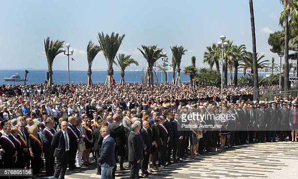French prime minister Manuel Valls observe a minute's silence in tribute to the victims of the deadly Nice attack at La Promenade des Anglais on July...
